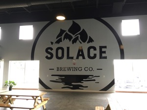 Solace Brewing Company logo in etched glass