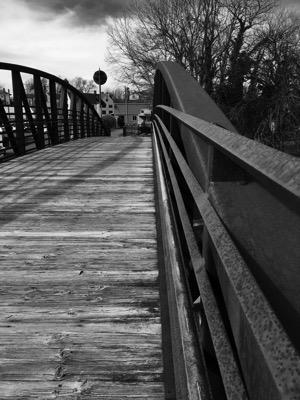 Black-and-white photograph of a re-purposed train trestle.