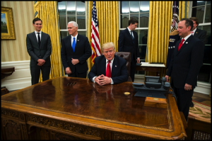 President Trump sitting at the Resolute Desk